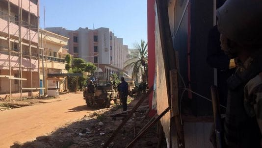 Malian troops take position outside the Raddison Blu hotel in Bamako Nov. 20.