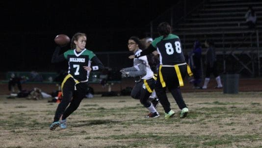 Quarterback Kallie Graves prepares to launch a pass during a game last season in Mesquite.