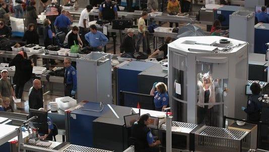 TSA agents at work.