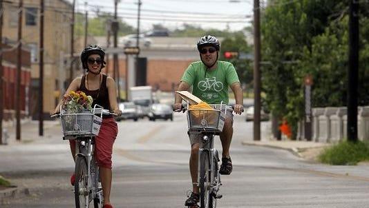 People ride their bikes in El Paso.