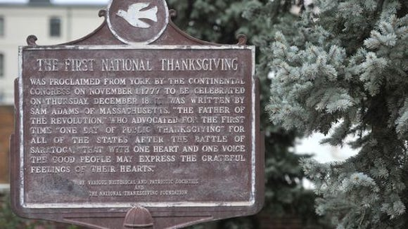 This sign, in a nice plaza off East Market Street, is a little weather beaten but tells a Thanksgiving story.