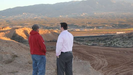 Mesquite liaison officer Aaron Baker, right, and field superintendent Jeremy Woods discuss progress on Exit 118.