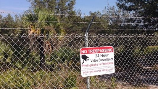 A sign on the perimeter of the would-be site of a controversial monkey farm on the Lee/Hendry  county border.