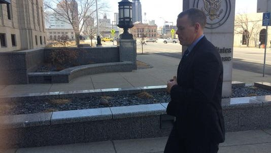 Former officer Colin Boone arrives at Des Moines' federal courthouse for a verdict in his March trial
