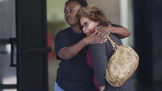 Women embrace after a mass shooting in San Bernardino, Calif., on Dec. 2, 2015.(