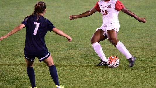 Brianne Reed (in white) did it all for Rutgers women's soccer this fall.