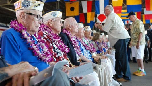 Pearl Harbor survivors gather on Dec. 7 in Pearl Harbor, Hawaii, before a ceremony marking the 74th anniversary of the Japanese attack that launched the U.S. into World War II.
