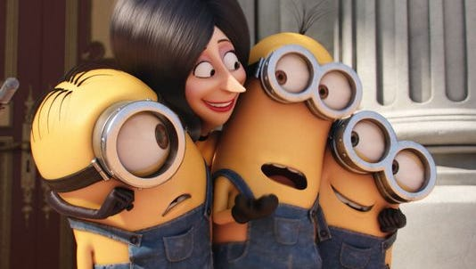 """The Minions and Scarlet Overkill (Sandra Bullock) in a scene from """"Minions."""""""