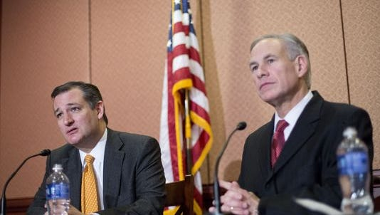 Republican presidential candidate Sen. Ted Cruz, R-Texas, left, and Texas Gov. Greg Abbott, right, speak about the resettlement of Syrian refugees in the U.S., during their joint news conference on Capitol Hill in Washington, Tuesday. Abbott was in Washington with Cruz to support a bill Cruz has introduced in Congress banning any refugees from Iraq, Syria or other countries deemed to be controlled by a foreign terrorist organization.