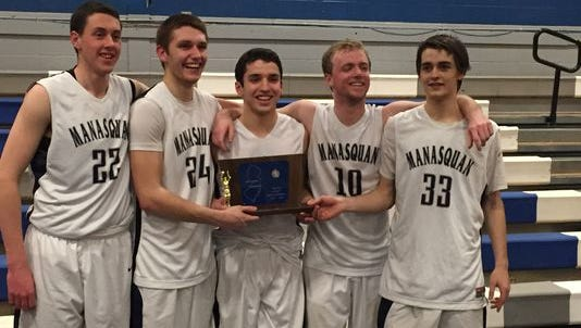 The Manasquan seniors hold the NJSIAA Central Group II trophy after the Warriors won the 2015 sectional title
