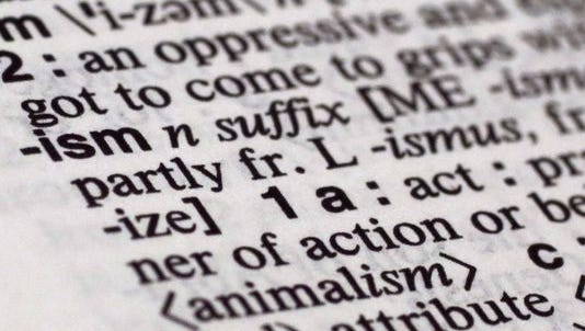 """The suffix """"ism"""" is photographed in Merriam-Webster's Collegiate Dictionary, in New York, Monday, Dec. 14, 2015."""