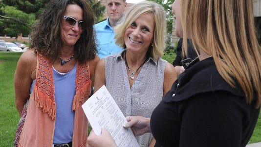 Mason residents Lee Chaney, 53, and Dawn Chapel, 54, were the first same-sex couple to get married in Ingham County by Clerk Barb Byrum after the U.S. Supreme Court's ruling on June 26. They waited 11 years to exchange vows legally.