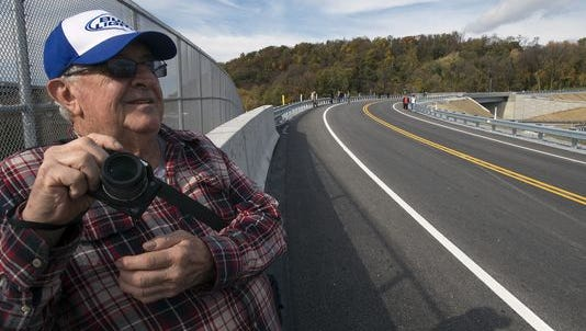 Larry Frable, of Mountville, took photos during a pedestrian tour of the Route 441 bridge over Route 30 last month. The new road was set to open last month, but problems with a traffic signal have delayed the opening. It is expected to open to traffic on Thursday.