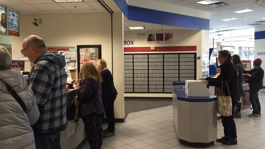 Customers line up at a U.S. Post Office in San Francisco on Dec. 17, as the holiday rush hits. A U.S. Postal Service truck. Between Thanksgiving and New Year's Eve of 2015 the Postal Service expects to deliver 600 million packages, a 10.5% increase over last year.