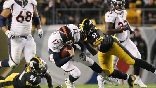 Dec 20, 2015; Pittsburgh, PA, USA; Denver Broncos quarterback Brock Osweiler (17) is hit by Pittsburgh Steelers linebacker Sean Spence (51) during the first half at Heinz Field.