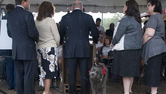 Camden County Freeholder Jeff Nash and his Dog Norman stand at the podium as he announces new legislation that prohibits the sale of puppy mills pets in Camden County.