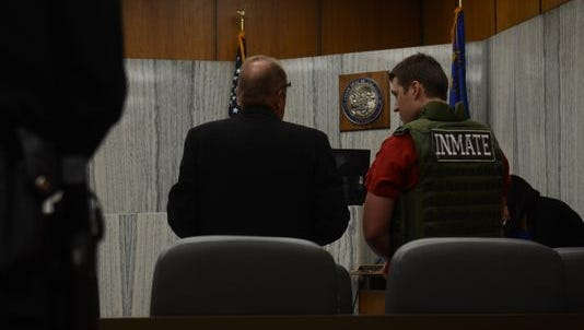 Jason Brown and his defense attorney, John Oakes speak to each other a sentencing hearing on Oct. 1, 2014.
