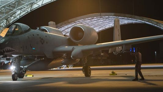 A crew chief marshals an A-10C for takeoff Sept. 19 at Moody Air Force Base, Ga., beginning a six-month deployment to Amani Air Base, Estonia, in support of Operation Atlantic Resolve.