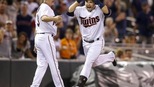 Brian Dozier's walk-off homer capped a 7-run 9th inning for the Twins.
