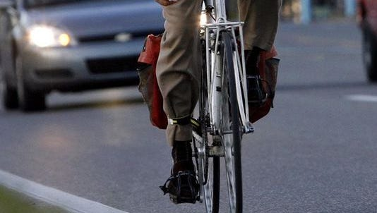 A bicyclist on the road.