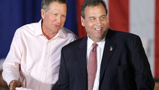 This Sept. 29, 2014 photo shows Ohio Gov. John Kasich, left, joking with New Jersey Gov. Chris Christie at a campaign rally in Independence, Ohio. In an interview with NBC's Meet the Press on Sunday, Jan. 3, 2016, Kasich criticized Christie's economic record as New Jersey governor.