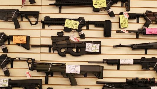 Weapons are seen on display at a gun store in Delray Beach, Fla.