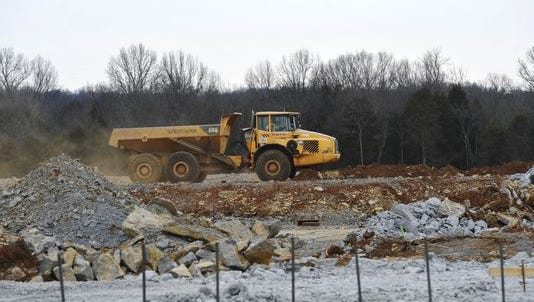 Heavy machinery moves material for the gym at Nolensville High School in January. The school district may start construction next year in Thompson's Station for a middle and elementary school.