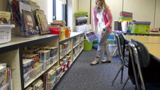 Kate Culbert is a fourth grade teacher at Lakes Elementary setting up her classroom at the beginning of the school year. Open enrollment for School of Choice at Hartland starts on Feb. 1.