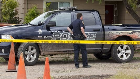 The Parowan Police Department investigate a shooting on Thursday July 10, 2014 in Parowan. PPD will now provide all policing services to Paragonah following Monday's Iron County Commission meeting.