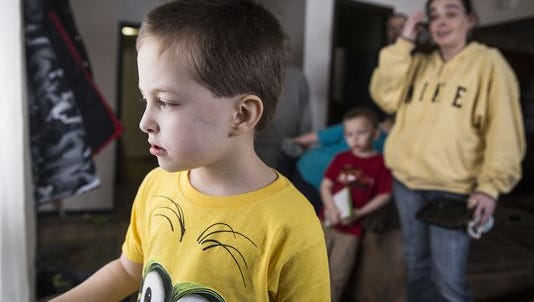 Tristan Stiffler, 6, looks out the front window at the snow Tuesday afternoon.