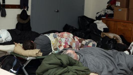 """About 25-30 men and women in need stayed at the Burt-Cobb Community Center each day during a brutally cold week in mid-February 2015. The center will not open this week unless there is a demand other agencies and churches can't handle. Photo(Photo: FOR THE LEAF-CHRONICLE/TONY CENTONZE))Buy Photo CONNECTTWEETLINKEDIN 5 COMMENTEMAILMORE  CLARKSVILLE, Tenn. – Despite heavy snow and ice and temperatures that were expected to drop into the single digits overnight, the City of Clarksville says there is no need to open an emergency warming shelter because beds are available through their partner agencies and through churches.  During the last snowstorm, the city opened Burt-Cobb Community Center to provide additional shelter. But city spokeswoman Jennifer Rawls said Mayor Kim McMillan did not order the emergency shelter open Wednesday or Thursday because there was """"no need for an emergency shelter at this time.""""  """"We are confident that there are a sufficient number of beds available through the Room In the Inn program, the Salvation Army, Buffalo Valley and through the Urban Ministries program to address the need for shelter during the next couple of days,"""" Rawls said Thursday morning. """"(Clarksville) Housing and"""