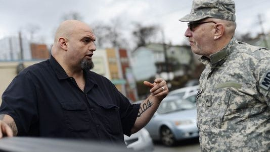 John Fetterman, left, Central York High School and Harvard grad, is making headlines as mayor of the rustbelt town of Braddock in western Pennsylvania.