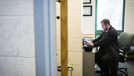 A counselor works in his office at the Youth Opportunity Center Thursday.