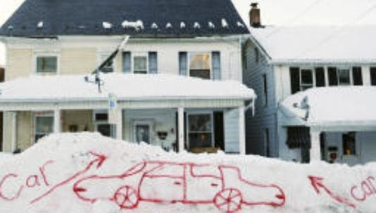 This spay-painted illustration is the only visible indicator that a car sits beneath the snow mound on First Avenue in Red Lion in the storm of 2010. This photograph became an icon of that storm - actually two storms in close proximity. Memorable photographs have helped define many storms in York County's past. But what is also memorable is the helpfulness of people you've never met before and might never meet again.