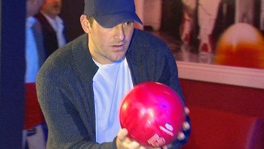 Tony Romo prepares to bowl at an event in Addison, Texas, on Saturday.