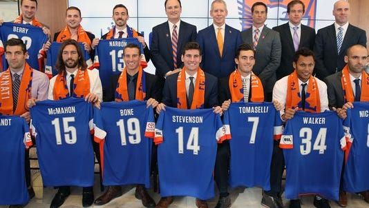 FC Cincinnati, a new professional soccer team, introduces their first class of players, coaches and staff at Queen City Tower Monday Dec. 7, 2015.