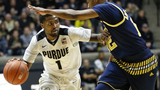 Purdue guard Johnny Hill (her playing against Muhammad-Ali Abdur-Rahkman of Michigan on Jan. 7, 2016) will be key to limiting turnovers in the game against Minnesota on Jan. 27, 2016.