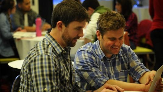 Ryan Mullins gets help from Nashville Eventbrite manager Durand Duin during a training session in 2014.