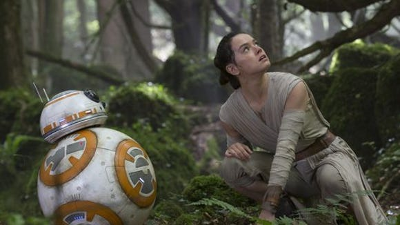 """BB-8 and Rey (Daisy Ridley) in a scene from """"Star Wars: The Force Awakens."""""""