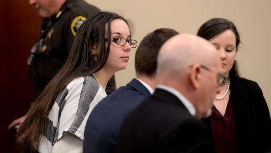 Melissa Mitin talks with her defense team Friday, Feb. 5, 2016, during a motion hearing in Judge James Jamo's courtroom at the Ingham County Courthouse in Lansing.