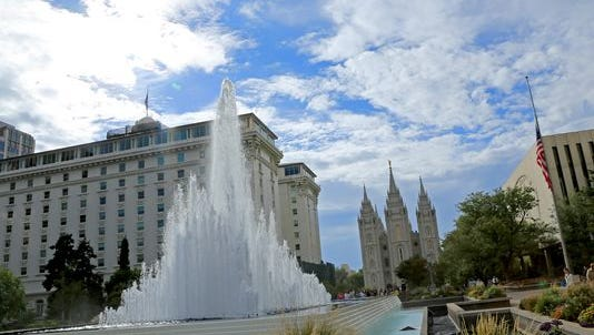 Members of The Church of Jesus Christ of Latter-day Saints walk through Temple Square in Salt Lake City following the afternoon session of the faith's General Conference last year.