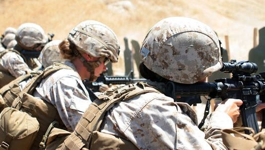 Marines with a female engagement team practice combat marksmanship at Camp Pendleton, California, in 2010. The logical next step after opening all direct ground combat jobs to women is to require women to register for the military draft, but the country should have a deep discussion about that, according to the author.