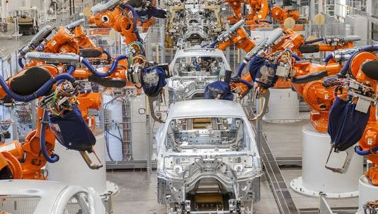 Robots assemble parts at BMW's X4 body shop in Greer.