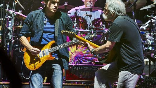 John Mayer, left, Bill Kreutzmann and Bob Weir of Dead & Company play during a 2015 concert at Madison Square Garden.