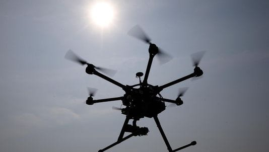 Officials at the University of Michigan are placing a temporary ban on drone use on the school's Ann Arbor campus until a final policy is created.