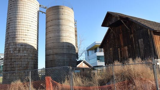 Fort Collins officials are struggling with what to do with a pair of 100-year-old silage silos next to the historic Coy-Hoffman barn on Woodward's new corporate campus.