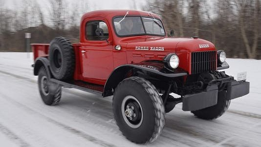 The 1948 Dodge Power Wagon, driven by Austin Potter, heads down the street.