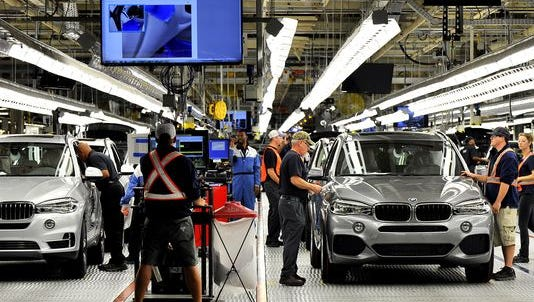 BMW vehicles roll through the assembly line at the automaker's plant in Greer.