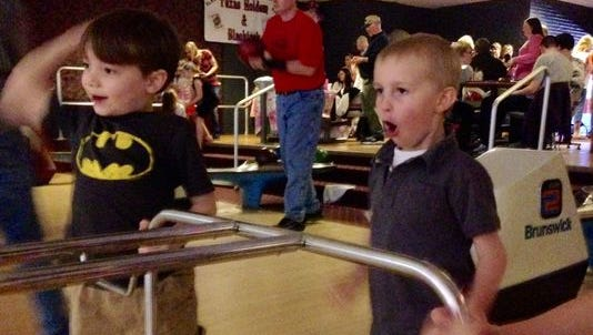 """6-year-old Henry Allen-Dollard bowls with friends during his grandmother's """"Hey, Hey Henry"""" fundraising event March 15. Proceeds benefit research for Barth syndrome."""