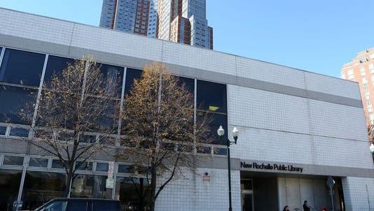 A developer is eyeing 1 Library Plaza as the possible anchor for a revitalized downtown. But the seven library trustees will ultimately decide what happens to the site.